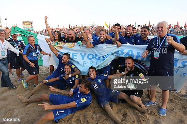 Italy players celebrate victory during the FIFA Beach Soccer World Cup 2017 Qualifier between Italy and Hungary on September 9 2016 in Jesolo Italy