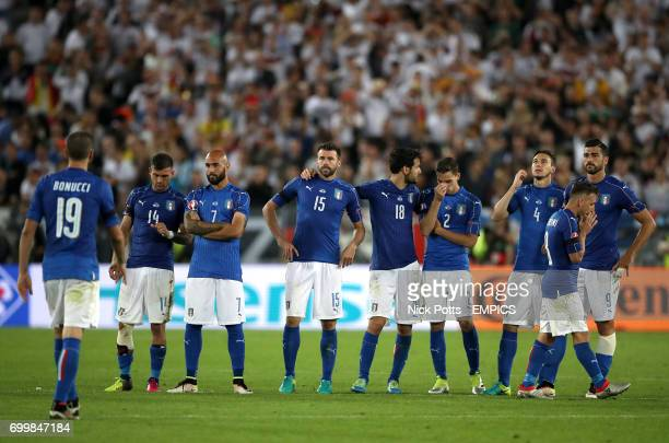 Italy players react after seeing teammate Leonardo Bonucci miss his penalty in the shootout