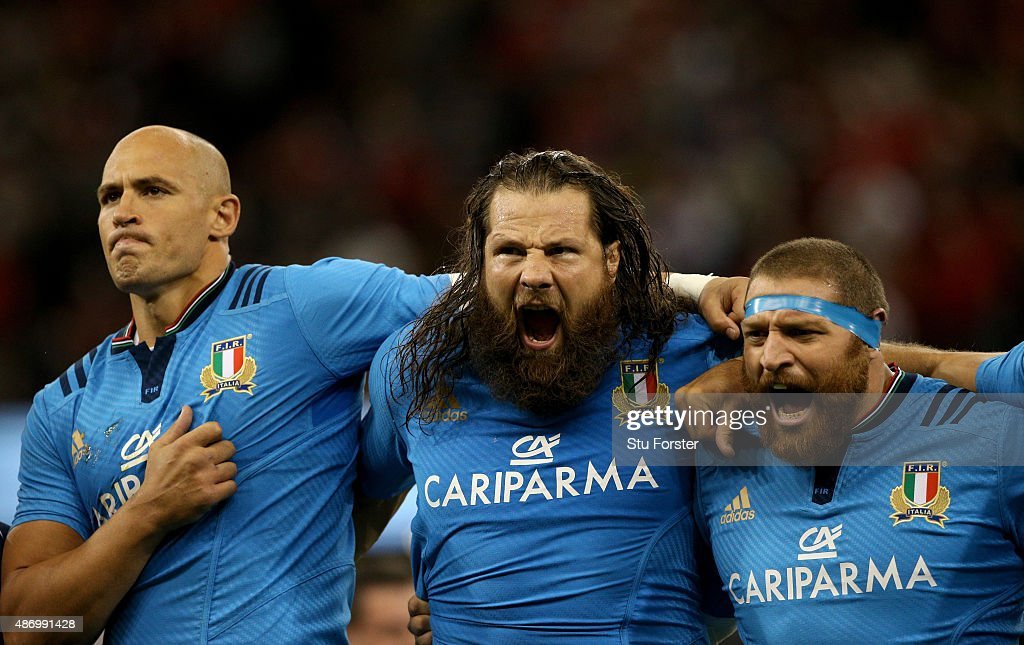 Italy players <a gi-track='captionPersonalityLinkClicked' href=/galleries/search?phrase=Sergio+Parisse&family=editorial&specificpeople=648570 ng-click='$event.stopPropagation()'>Sergio Parisse</a> (l) <a gi-track='captionPersonalityLinkClicked' href=/galleries/search?phrase=Martin+Castrogiovanni&family=editorial&specificpeople=802311 ng-click='$event.stopPropagation()'>Martin Castrogiovanni</a> (c) and Matias Aguero sing the national anthem before the International match between Wales and Ireland at Millennium Stadium on September 5, 2015 in Cardiff, Wales.