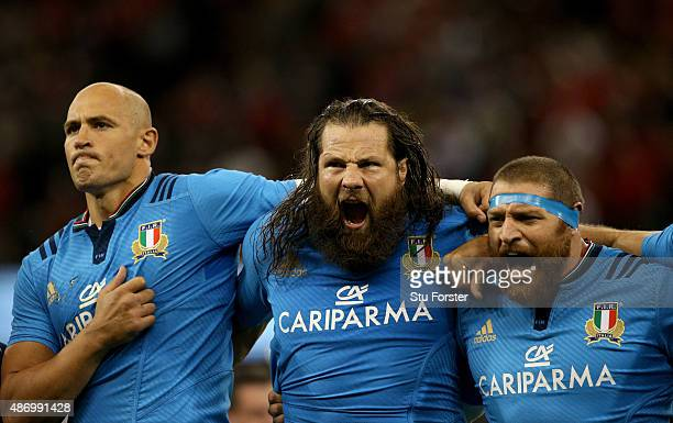 Italy players Sergio Parisse Martin Castrogiovanni and Matias Aguero sing the national anthem before the International match between Wales and...