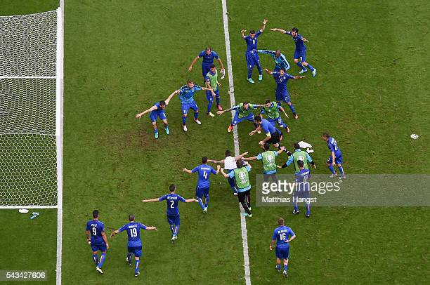 Italy players urge Gianluigi Buffon to jumps to cling on the crossbar to celebrates his team's 20 win in the UEFA EURO 2016 round of 16 match between...