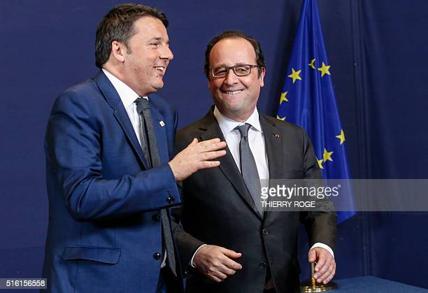 Italy Prime Minister Matteo Renzi and France President Francois Hollande share a light moment on the first day of an EU summit meeting on March 17...