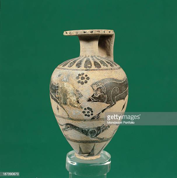 Italy Puglia Taranto Museo Archeologico Nazionale All Globeshaped Protocorinthian aryballos with a narrow neck squared lip and quadrangular handle...