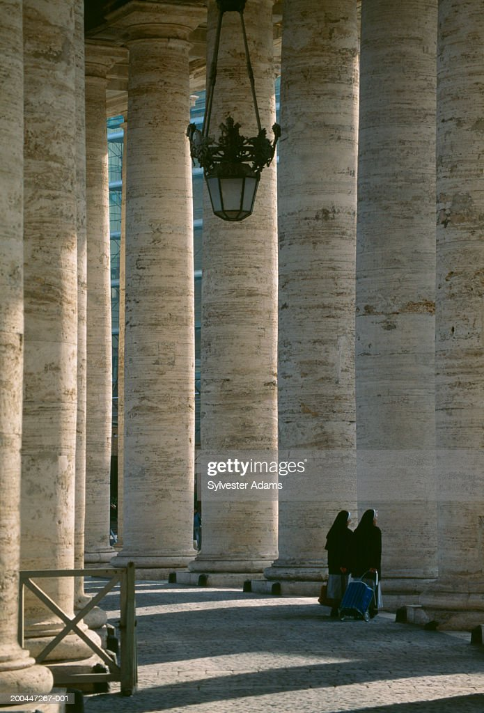 Italy, Rome, Basilica of Saint Paul, two nuns walking, rear view