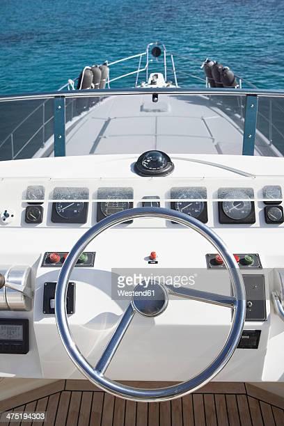 Italy, Sardinia, Steering wheel of luxury yacht