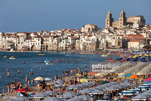 Italy, Sicily. Cefalu. Bathers on  the beach.