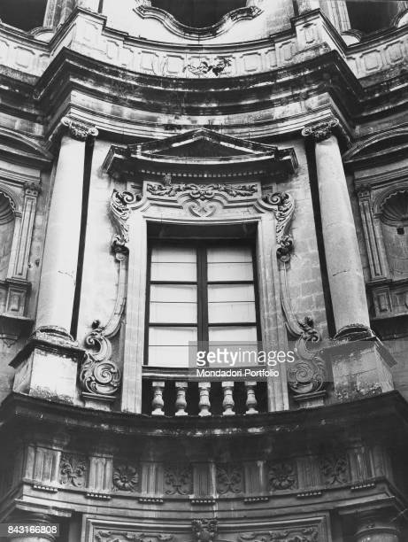 Italy Sicily Noto St Carlo al Corso Detail Detail of the convex facade of the church of of St Carlo al Corso with the window framed by columns