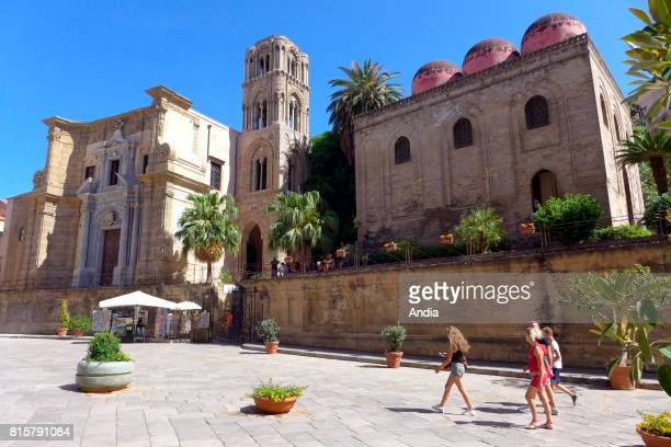 Italy Sicily Palermo Tourists in Bellini Square under the blue sky On the left the church of Santa Maria dell'Ammiraglio commonly called the...