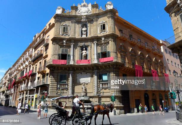 Italy Sicily Palermo Tourists on a horsedrawn carriage in the square Piazza I Quattro Canti nerve centre of the city composed of the junction of via...