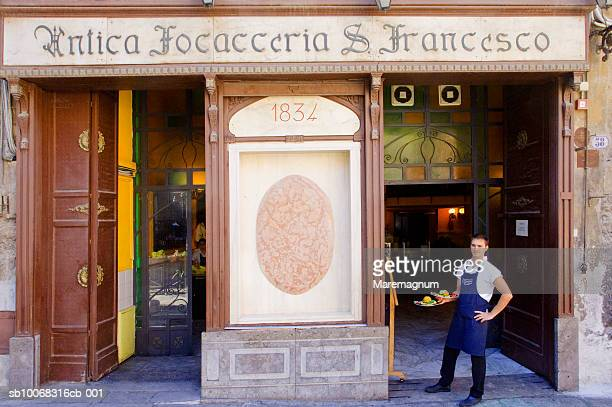 Italy, Sicily, Palermo, waiter outside Antica Focacceria San Francesco