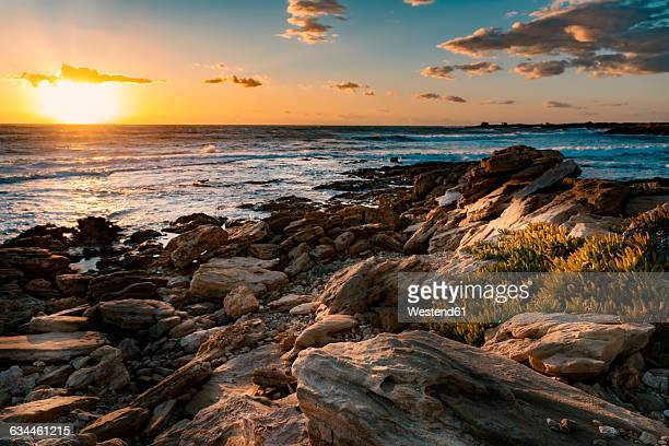 Italy, Sicily, Ragusa, Coast of Punta Braccetto at sunset