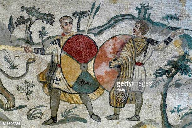 the Villa Romana del Casale Detail of the Little Hunt mosaic depicting to hunters with shields Hunter wearing tunic with swastika his shield...