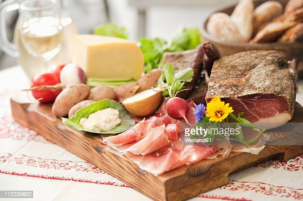 Italy, South Tyrol, Fresh snacks on chopping board