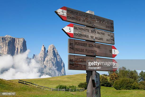 Italy, South Tyrol, Signpost at Seiseralm and Schlern group