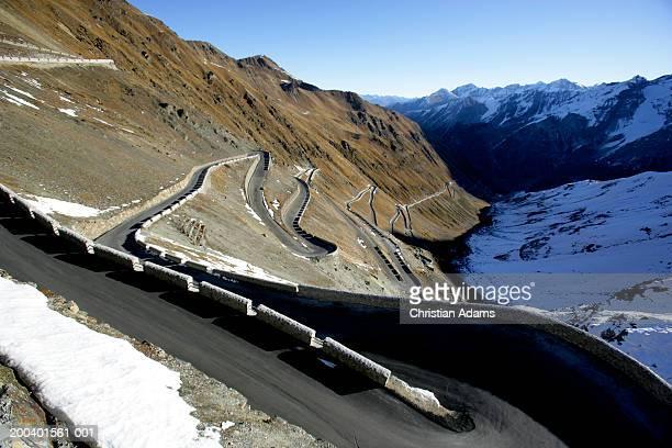 Italy, Stelvio Pass, sharp turn on mountain road