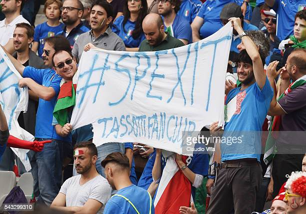 Italy suppoerters hold a banner 'Spexit' hoping Italy's win prior to the UEFA EURO 2016 round of 16 match between Italy and Spain at Stade de France...