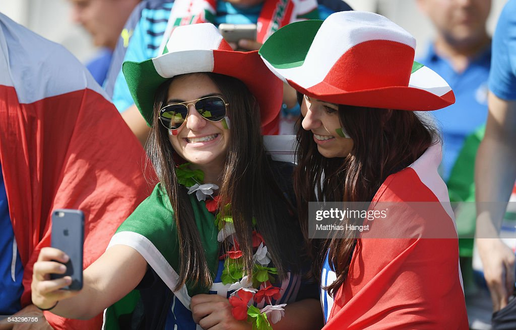 Italy supporters take selfie photographs prior to the UEFA EURO 2016 round of 16 match between Italy and Spain at Stade de France on June 27, 2016 in Paris, France.