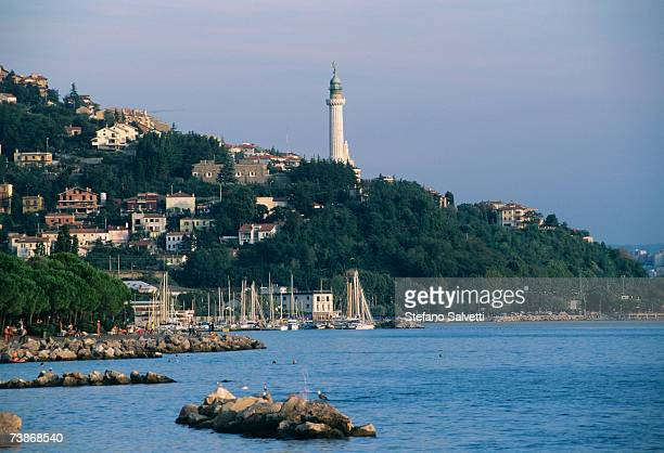 Italy, Trieste, Town on hill, Vittoria lighthouse