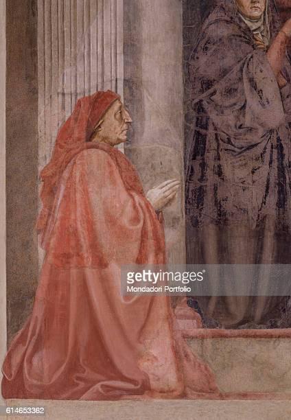 Italy Tuscany Florence Basilica di Santa Maria NovellaBerto di Bartolomeo kneeling in prayer Behind him Virgin Mary pointing at her son on the cross