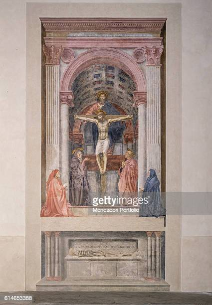 Italy Tuscany Florence Basilica di Santa Maria NovellaCoffered barrelvaulted chapel surrounding the Holy Trinity At the foot of Christ Virgin Mary...