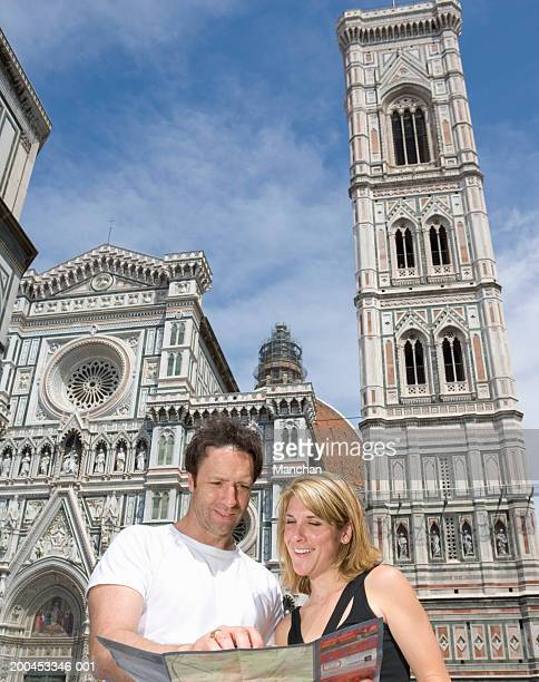 Italy, Tuscany, Florence, couple reading map by Duomo