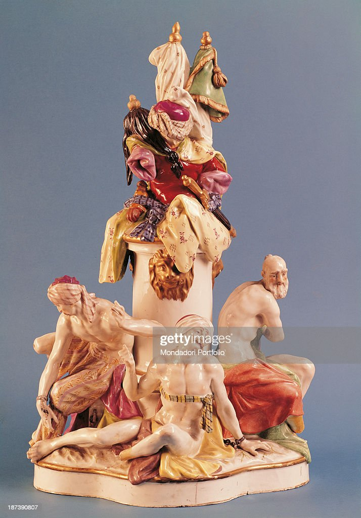 Italy Tuscany Florence Museo Stibbert All knickknack statuette with a white column in the middle three halfnaked Moors at the base two of which are...
