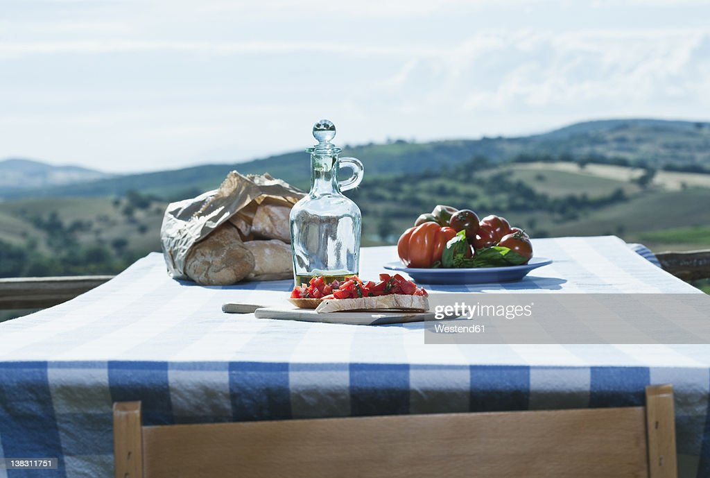 Italy, Tuscany, Magliano, Bruschetta, bread, tomatoes and olive oil on table