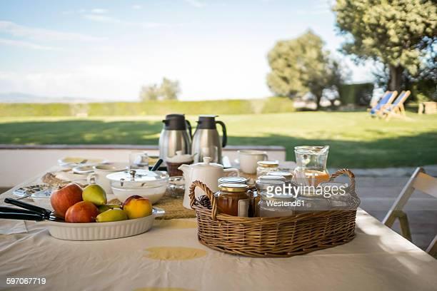 Italy, Tuscany, Maremma, laid breakfast table on terrace