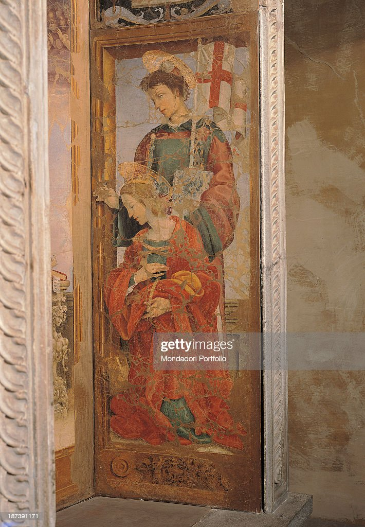 Italy, Tuscany, Prato, Museo Civico, Detail, Saint Stephen stands with a stone on his head holding a banner in his left hand, Saint Catherine of Alexandria is kneeled beside a wheel, the symbol of her martyrdom, wearing a red cloak, They both have aureola on their heads,