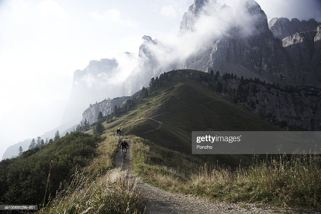 Italy, Tyrol,  bikers riding on mountain ridge : Stock Photo