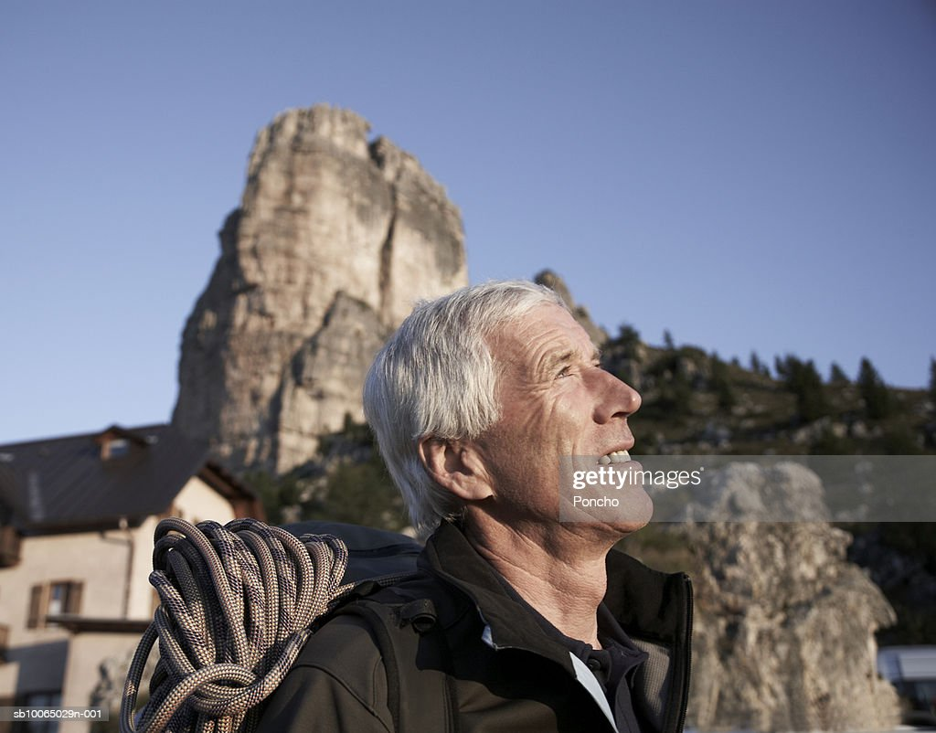 Italy, Tyrol, senior hiker standing outdoors, side view, close up : Stock Photo