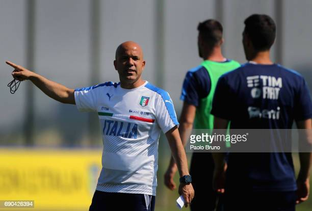 Italy U21 head coach Luigi Di Biagio speaks with his players during the Italy U21 training session at Mancini sport center on May 31 2017 in Rome...