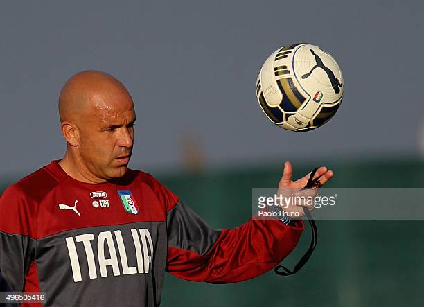 Italy U21 head coach Luigi Di Biagio with the ball during the Italy U21 training session at the Mancini sports center on November 10 2015 in Rome...