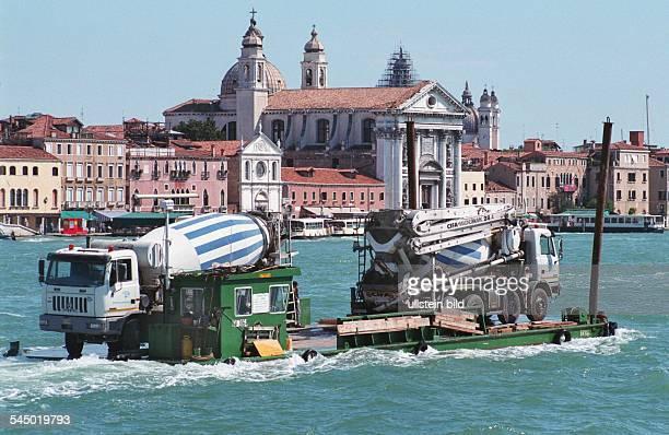 Italy Venedig Venezia Venice vehicles with concrete mixer on cargo ship in the Canale della Giudecca