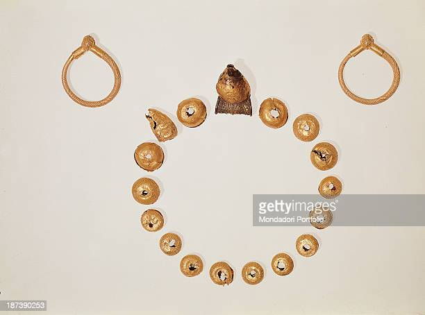 Italy Veneto Adria Museo Archeologico Nazionale All Necklace and earrings made by embossing and fusion parts of a female wedding trousseau