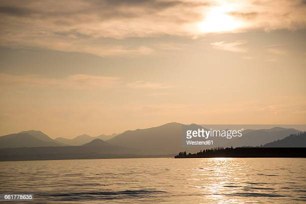 Italy, Veneto, Bardolino, Lake Garda at sunset