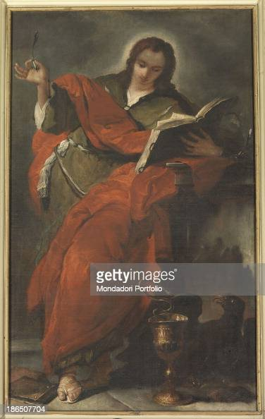 Italy Veneto Belluno Duomo Whole artwork view The apostle holding a pen and a book probably in the act of writing a Gospel passage In the lower part...