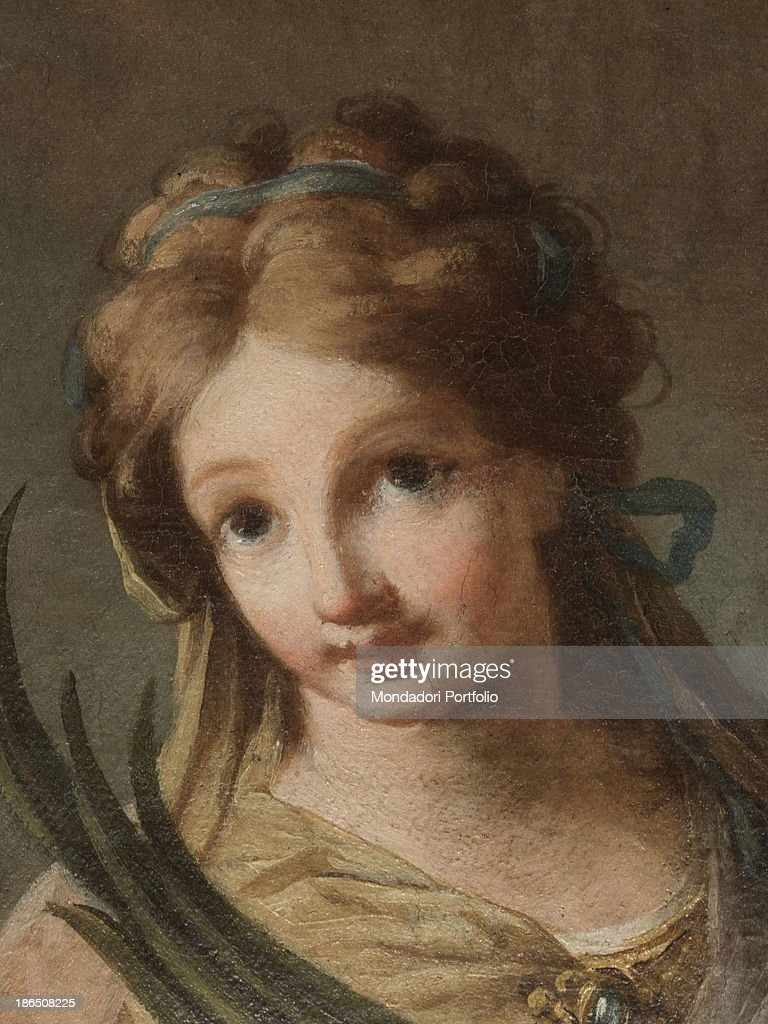Italy, Veneto, Belluno, Irrighe d'Alpago, fractional church, Detail, Close-up of the saint Apollonia martyr, where the goodness and kindness of the young woman is noticeable in the eyes and in the light, delicate complexion.