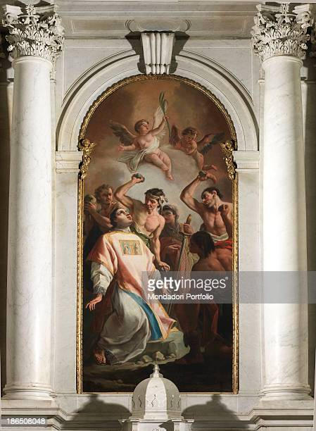 Italy Veneto Treviso St Stephen's Church Whole artwork view The stoning of the Saint by a crowd of men with stones in hand In the upper part angels...