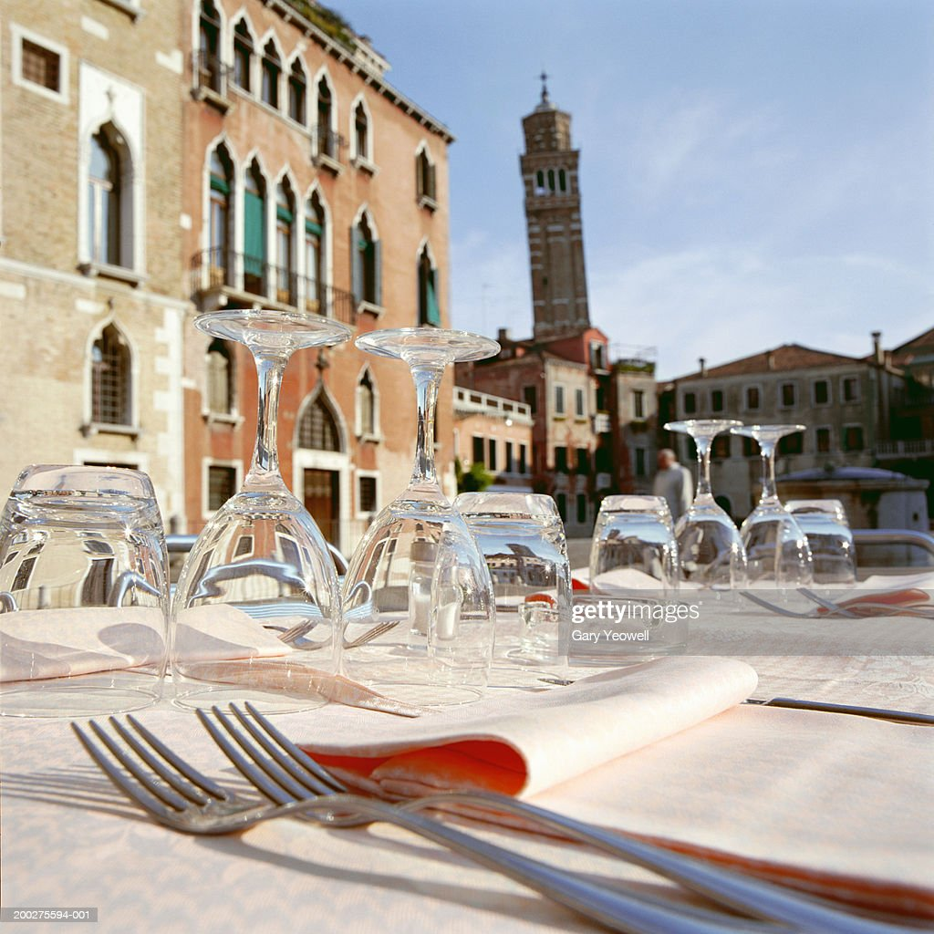 Italy, Veneto, Venice, glasses and cutlery on table in outdoor cafe : Stock Photo