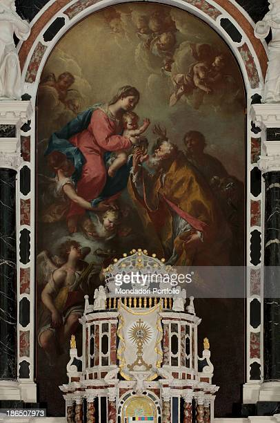 Italy Veneto Vicenza Camisano Vicentino parish Whole artwork view The Virgin Mary with Baby Jesus at their feet the saints wishing to touch a Baby's...