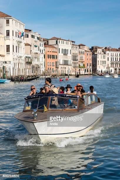 boat waterbus transporting Asian tourists on the Grand Canal