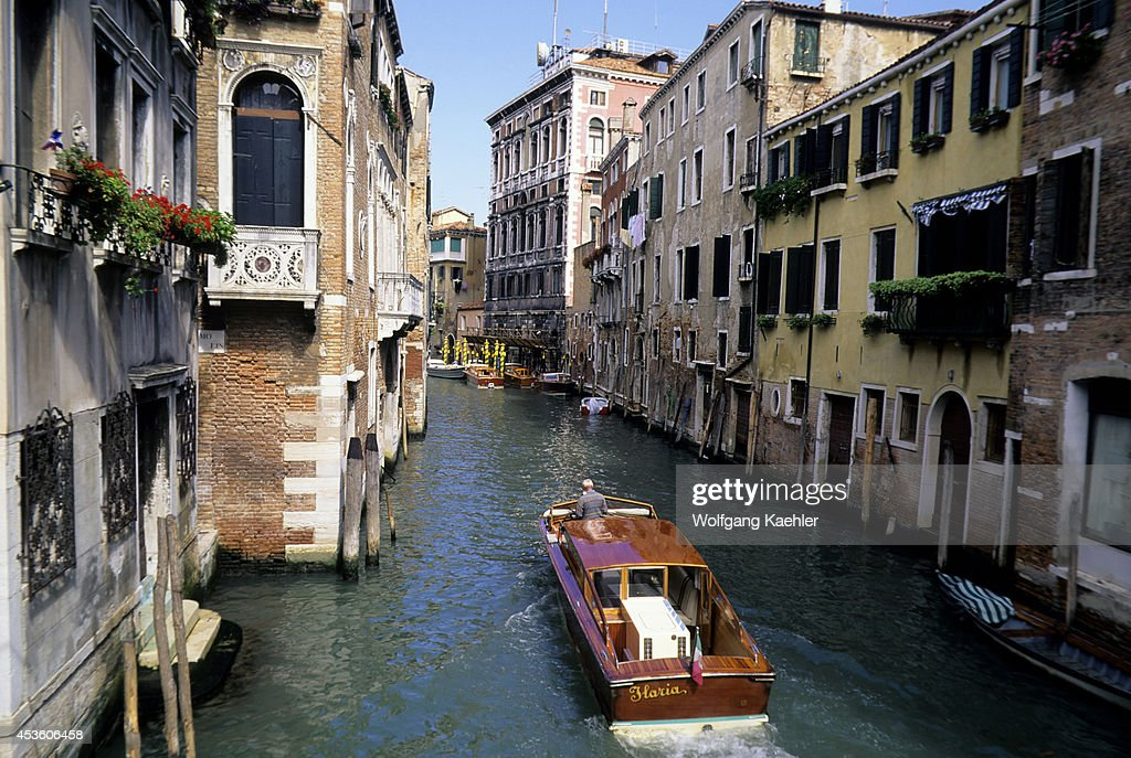 Italy Venice Canal With Water Taxi