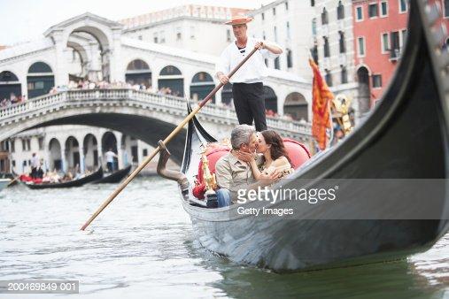 Italy, Venice, couple riding gondola, kissing