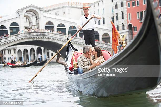 Italy, Venice, couple riding gondola, kissing