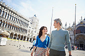 Italy, Venice, couple walking through St Mark's Square, holding hands