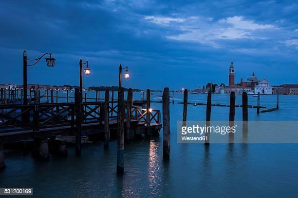 Italy, Venice, gondolas at dusk with view to San Giorgio Maggiore