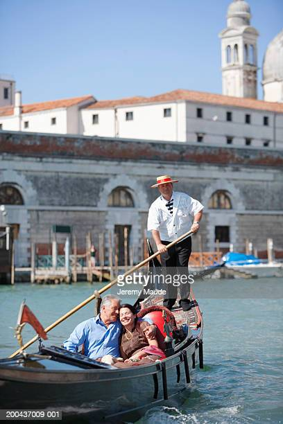 Italy, Venice, mature couple in gondola, heads together, smiling