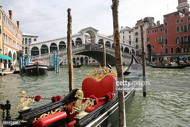 Italy Venice Rialto Bridge With Ornamented Gondola In The Foreground