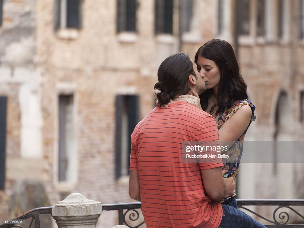 Italy, Venice, Young couple kissing : Stock Photo